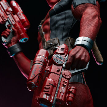 close up on water guns of Deadpool Third Scale Statue with dark background