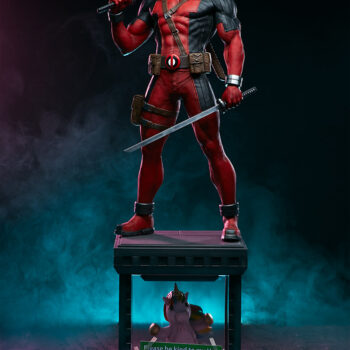 full view of Deadpool Third Scale Statue with pink and blue smoke in background