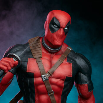 close up on torso of Deadpool Third Scale Statue with pink and blue smoke in background