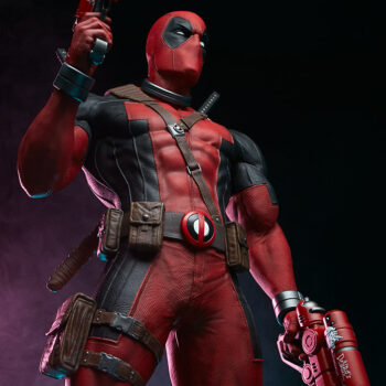 looking up at the Deadpool Third Scale Statue with water guns