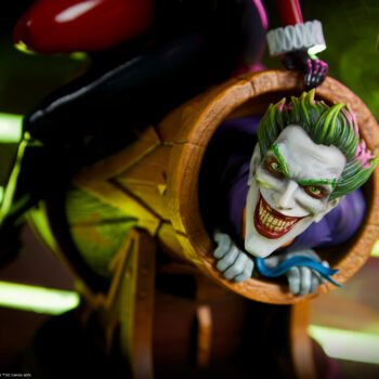 close up on The Joker in the Harley Quinn and The Joker Diorama with Joker Toxin in the background