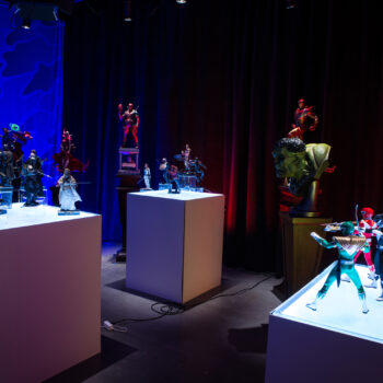 (from left to right) Lights off in MicroCon display with The Mandalorian, Marvel, and Power Rangers collectibles close up