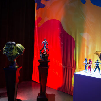 (from left to right) Lights off in MicroCon Display with Marvel and Power Rangers Collectibles