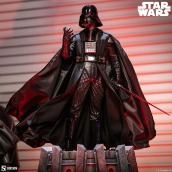 Looking up at the Darth Vader Premium Format Figure with red lights behind
