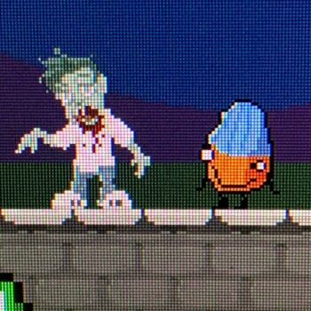 Level! Up With Ser Sideshow video game 8-bit pixel art characters Mort (zombie) and Rubbish Bill (blue covered almond with googly eyes)