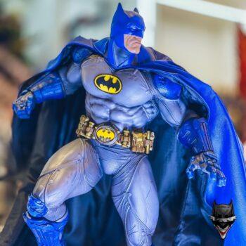 Batman Premium Format Figure perched in a collectible