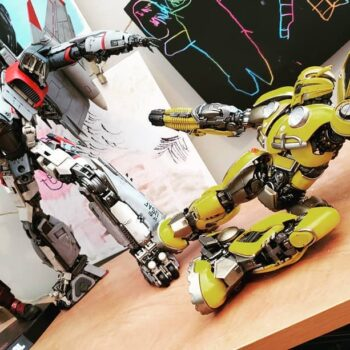 Bumblebee sliding on a shelf in front of other transformer collectibles