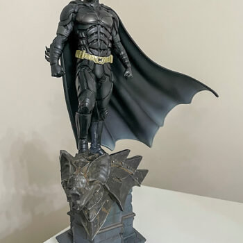 Batman figure on gargoyle head