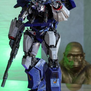 Transformer collectible in front of green light and king kong collectible