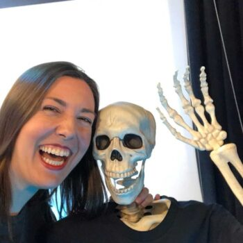 Amy with a fake skeleton wearing a Sideshow shirt