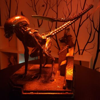 Xenomorph lunging forward in red lit room