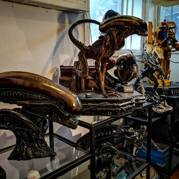 Alien collectibles on glass display