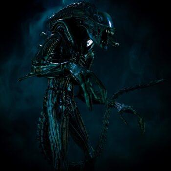 Alien collectible in dark smokey room