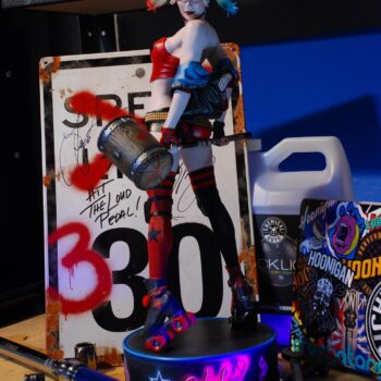 Harley Quinn Hell on Wheels Premium Format Figure in front of speed limit sign