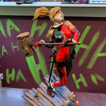Harley Quinn Premium Format Figure in front of wall with green Ha Ha's