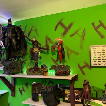 Gotham City collectibles with Ha Ha's written on red on green wall