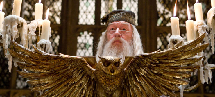 Dumbledore addresses the students of Hogwarts from the podium in the Great Hall
