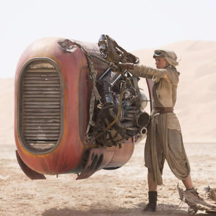 Rey scavenges for valuable parts and scraps on Jakku in Star Wars: The Force Awakens