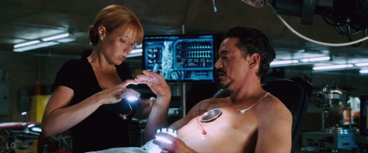 In a rare moment of vulnerability, Tony asks for Pepper's help in repairing his reactor