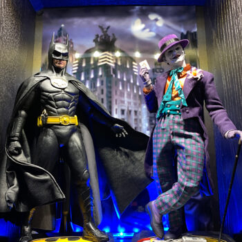 Batman and The Joker in front of Gotham city light display