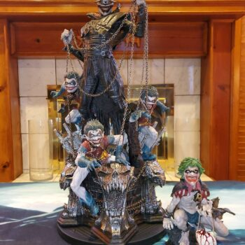 Batman who laughs collectibles on a table