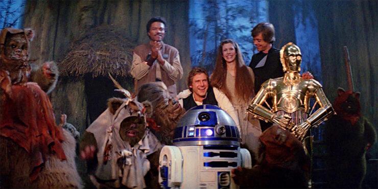 Lando, Han, R2D2, Leia, C3PO, and Luke celebrate victory on Endor