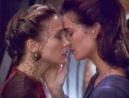 Jadzia Dax and Lenara can't help but express their passion for each other in Star Trek Deep Space 9