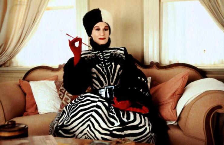Cruella sits in her office